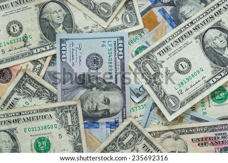 variety of US dollar bills background - stock photo