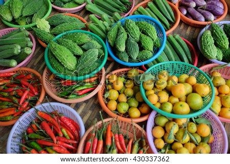 Variety of vegetable displayed in the colorful basket. - stock photo