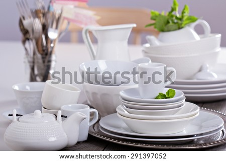 Variety of white dinnerware: plates, cups and bowls - stock photo