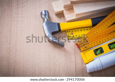 Variety of working building tools on wood board horizontal version construction concept. - stock photo