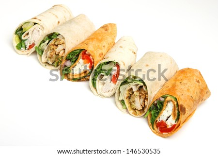 Variety of wrap sandwiches arranged in a line.