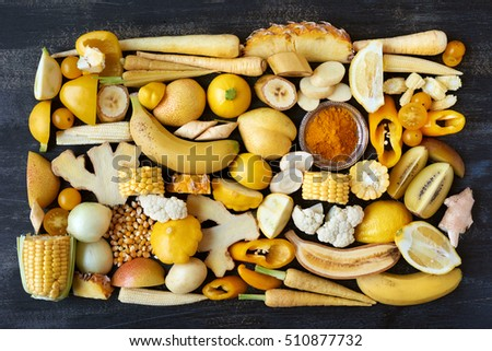 Variety of yellow toned fruit and vegetables, food background poster overhead part of full colour collection in portfolio