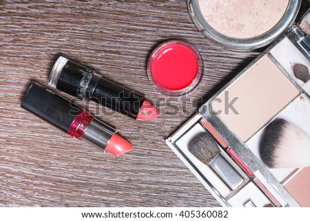 variety woman make up cosmetic on vinyl wood  background / selective focus