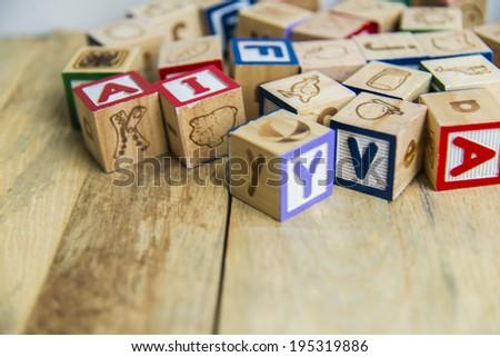 Variety wooden blocks on wooden floor - stock photo