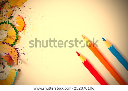 variolored pencil and shavings on a white background. instagram image retro style - stock photo