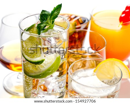 Various alcoholic cocktails on white background - stock photo