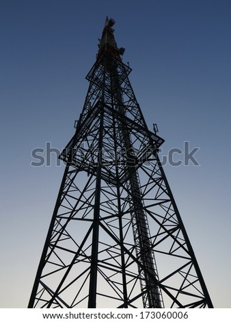 Various antenna against blue sky - stock photo