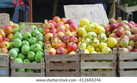 Various Apples Fruits in Crates at Farmers Market - stock photo
