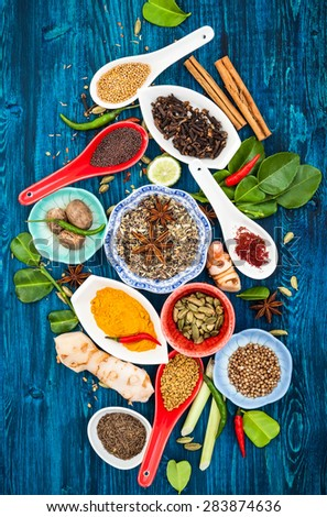 Various asian spices and herbs on a blue wooden background.Top view - stock photo