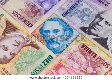 Various banknotes from Argentina on the table - stock photo
