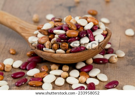 various beans on wooden surface - stock photo