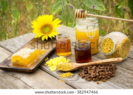 Various bee products placed on a wooden table