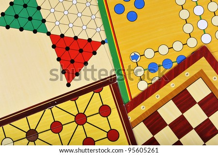 Various board games of ludo, halma, chess and fox and geese - stock photo