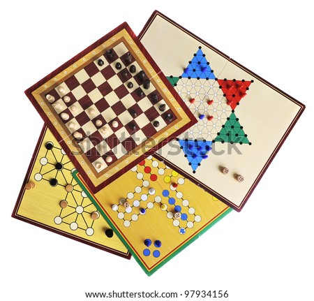 Various board games of ludo, halma, chess and fox and geese isolated on white - stock photo
