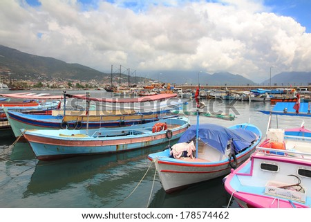 various boats and yachts stand at the pier in Alanya Turkey - stock photo