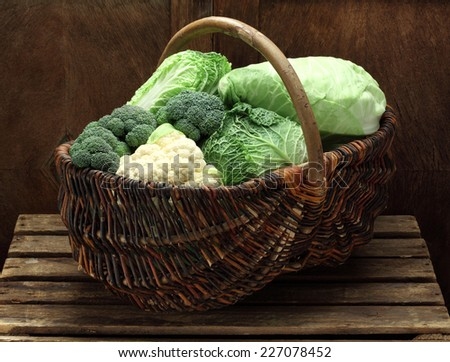 Various cabbages in a basket - stock photo