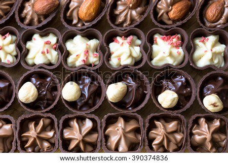 various chocolates as a background - sweet food - stock photo