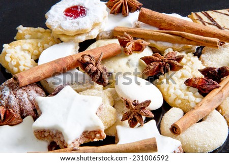 Various christmas cookies and spices - stock photo