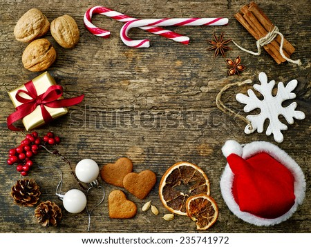 various Christmas decorations on old wooden table - stock photo