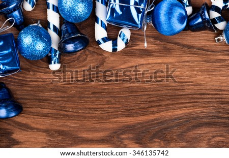 Various Christmas toys on the tree on an empty wooden background - stock photo