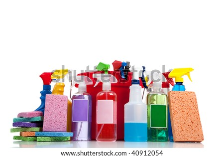 Various cleaning supplies including sponges on a white background with copy space