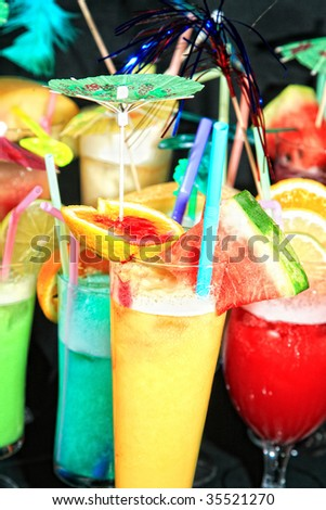 Various cocktails on black background - stock photo