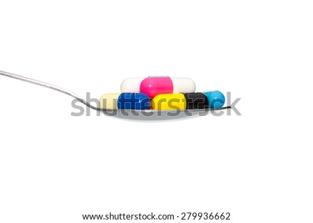 Various color drug or pill or vitamin on metal Spoon isolated on white background. Concept about health care or medical or science including food concept. - stock photo