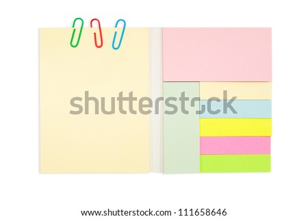 various color note pad and paper clip isolated on white background