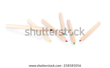Various color pencils on white background with shadow and reflection - stock photo