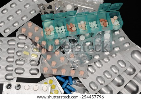 Various colored daily pills - stock photo