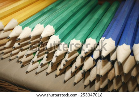 Various colored pencils in row as a creativity close up - stock photo