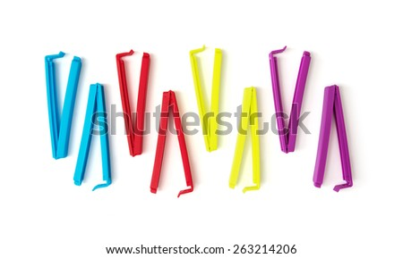 Various colorful bag clips on the white background.