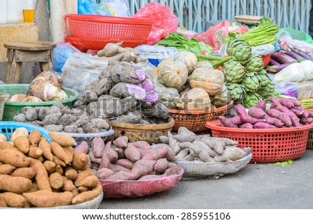 Various colorful fresh fruits and vegetables at street market, Ho Chi Minh city, Vietnam  - stock photo