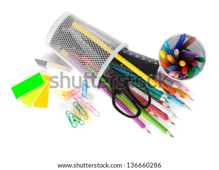 Various colorful pencils and office tools. View from above. Isolated on white background - stock photo