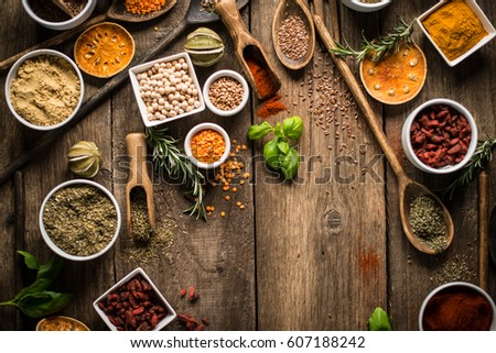 Various colorful spices on wooden table. Place for typography and logo