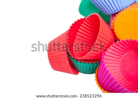 Various colors of silicone cupcake silicone baking cups over white background
