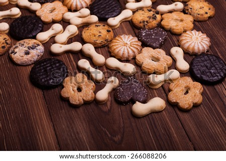 Various cookies on the brown wooden table