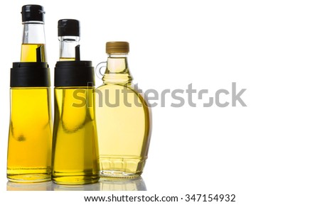 Various cooking oil over white background