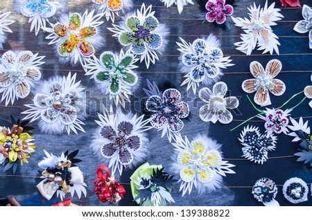 various cute handmade women jewelry decorations brooch pin breast-pin sold in outdoor street market fair. - stock photo