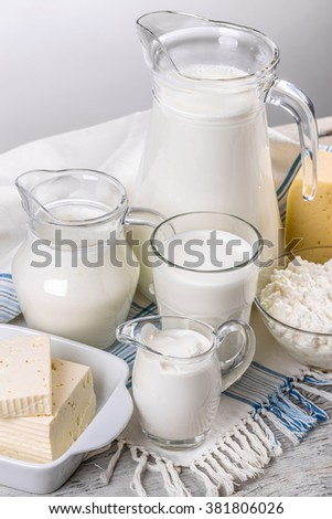 Various dairy products on rustic table