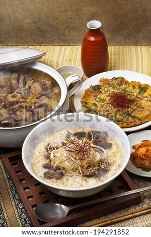 Various dishes, including meat, rice and a baked vegetable bread. - stock photo