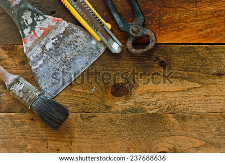 Various diy tools on old rustic work bench - stock photo