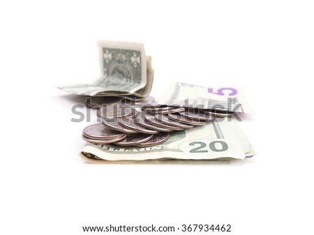 Various dollar bills and coins isolated on white - stock photo
