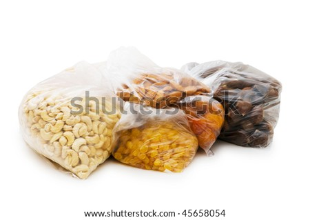 Various dry fruits in the bags on white
