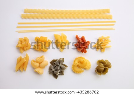 various dry pasta on the white background - stock photo