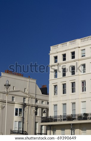 Various Edwardian style properties on a corner of a street on a bright blue sky day in Lond, UK - stock photo