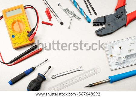 Various Electrician Tools And Components Including A Multimeter Screwdrivers Wirecutters Drill Bits