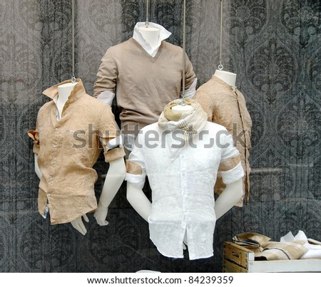 various fashionable men's shirt in shop window - stock photo