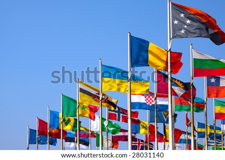 Various flags on blue sky