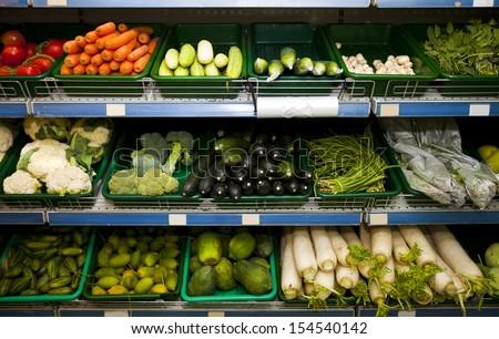 Various fresh vegetables in supermarket - stock photo